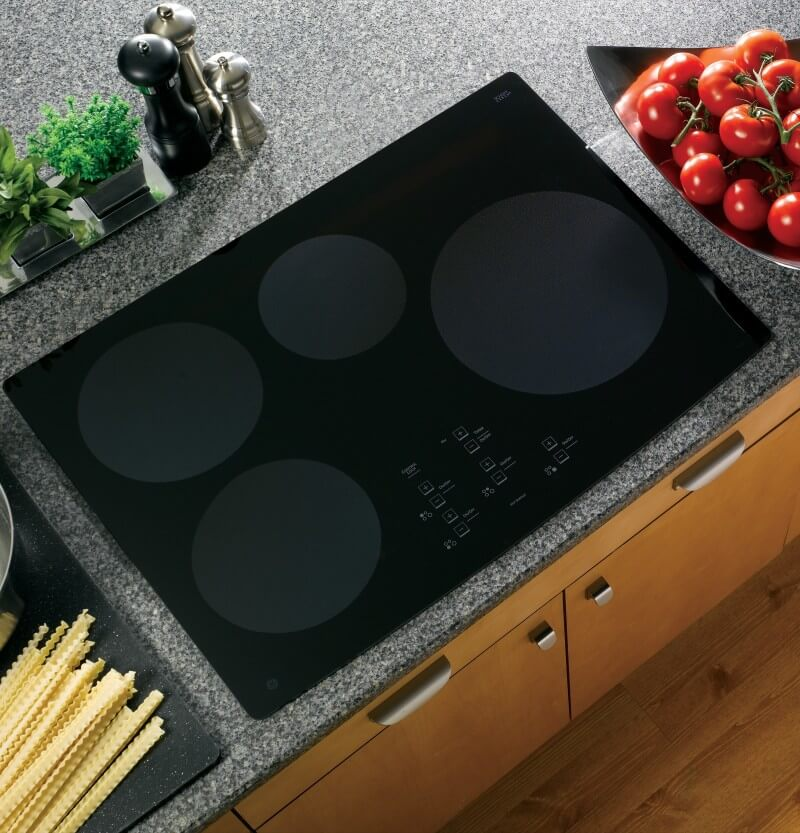 "A GE Profile CleanDesign 30"" Induction Cooktop directly installed into the countertop."