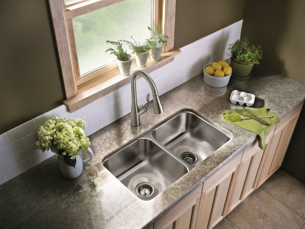 The Moen 7594CSL Stainless High Arc Pulldown Kitchen Faucet fits this kitchen's finish perfectly.