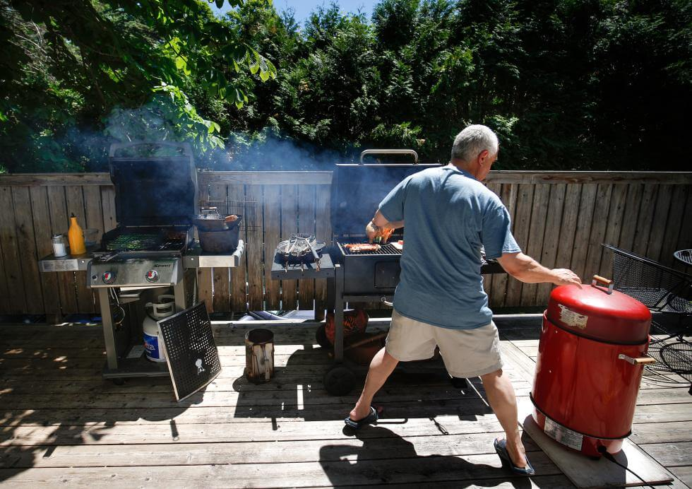 Photo Credit: DAN LITTLE Gazette food writer Lou Groccia with, from left, his gas grill, charcoal grill and electric smoker.